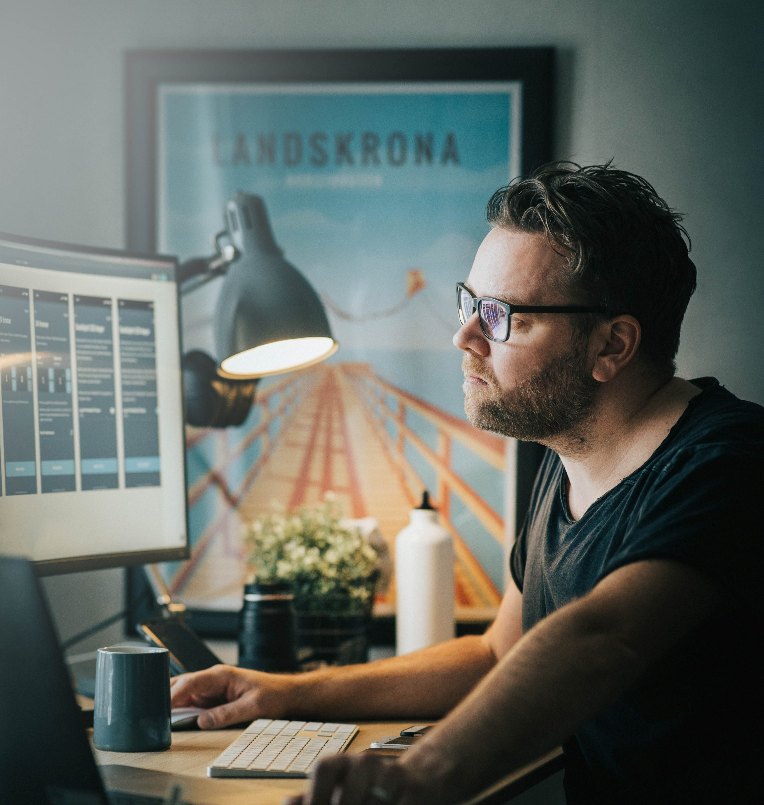Man at computer planning to scale